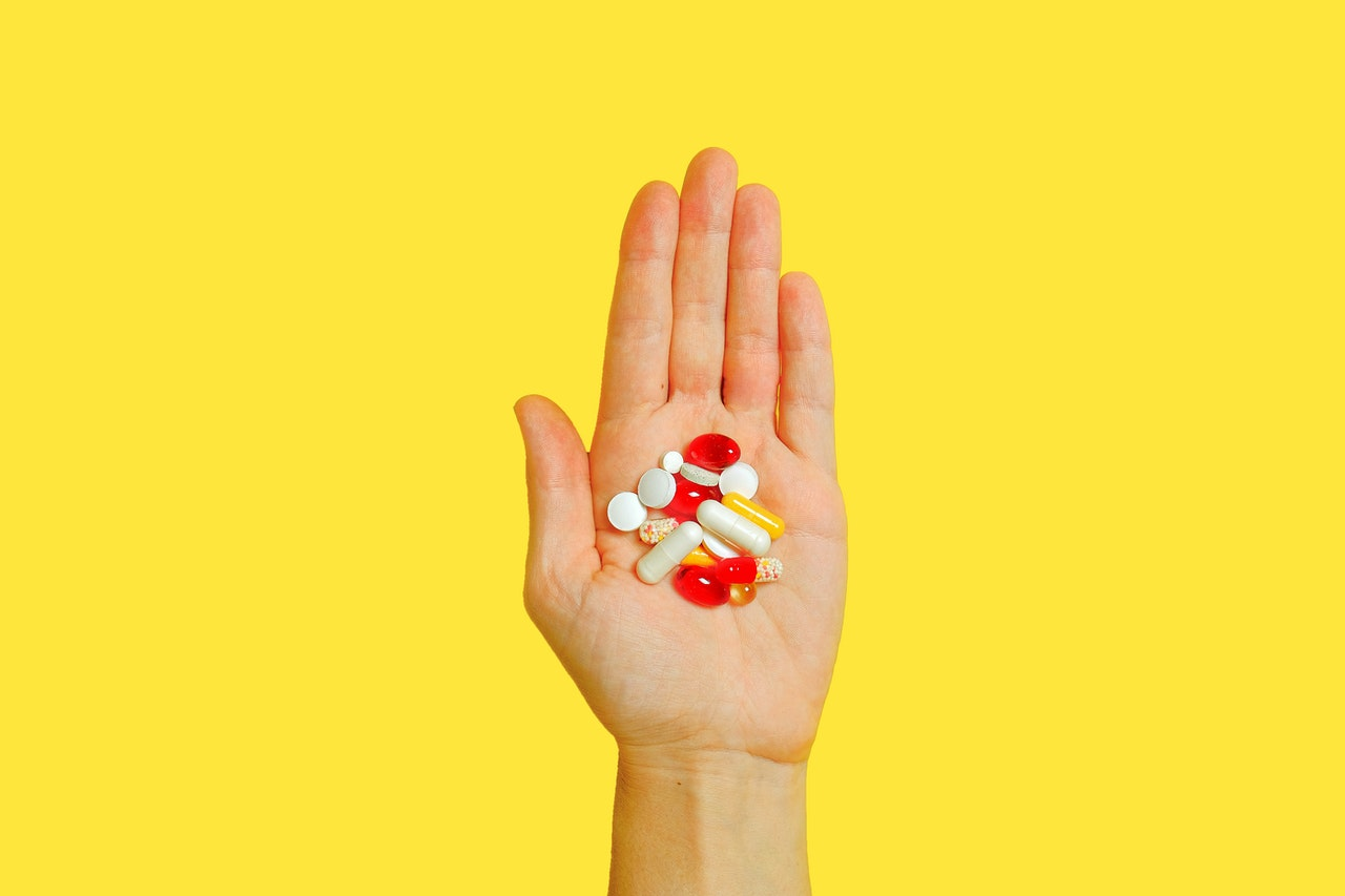 hand with supplements